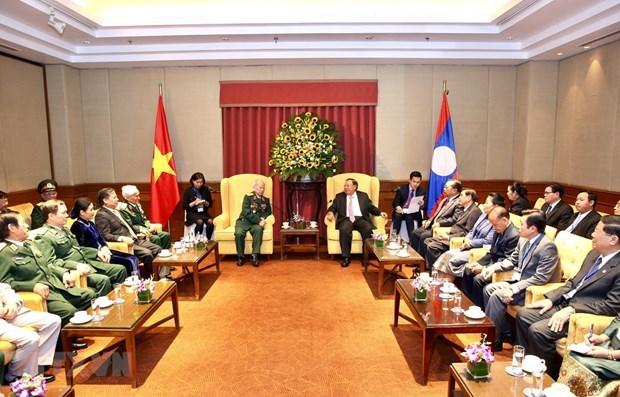 Se reune maximo dirigente de Laos con exsoldados voluntarios vietnamitas hinh anh 1