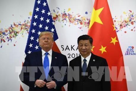 Debaten sobre el impacto en la economia mundial de las relaciones entre Estados Unidos y China hinh anh 1