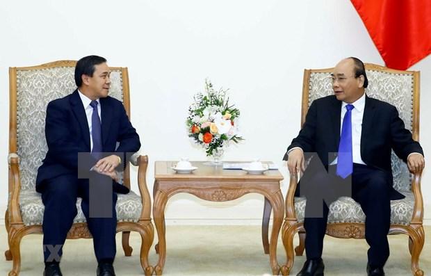 Recibe primer ministro vietnamita a nuevo embajador laosiano hinh anh 1