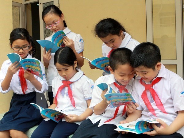 Fortalece Vietnam compromiso con implementacion de los derechos de los ninos hinh anh 1
