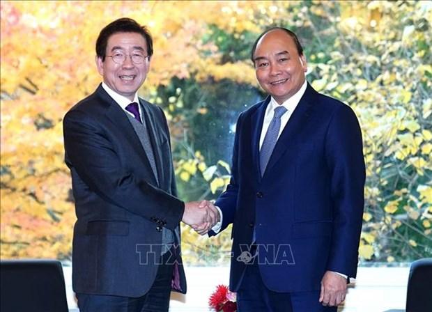 Efectua primer ministro de Vietnam reunion con alcalde de Seul hinh anh 1