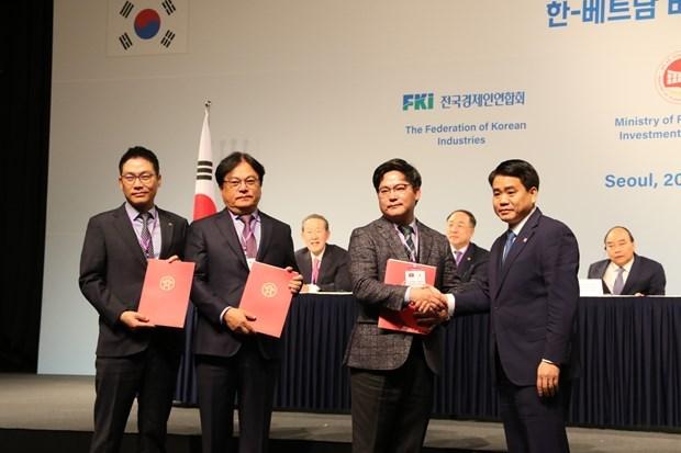 Hanoi intercambia documentos de cooperacion con Corea del Sur hinh anh 1
