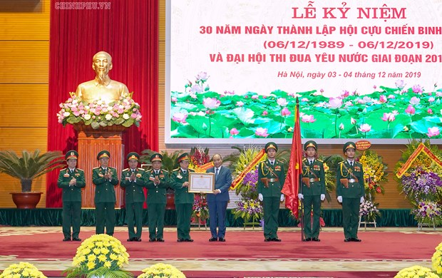 Elogia primer ministro de Vietnam aportes de veteranos de guerra al desarrollo nacional hinh anh 1