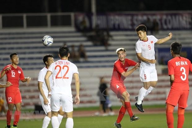 SEA Games 30: Vietnam da paso hacia semifinales tras vencer 1-0 a Singapur hinh anh 1