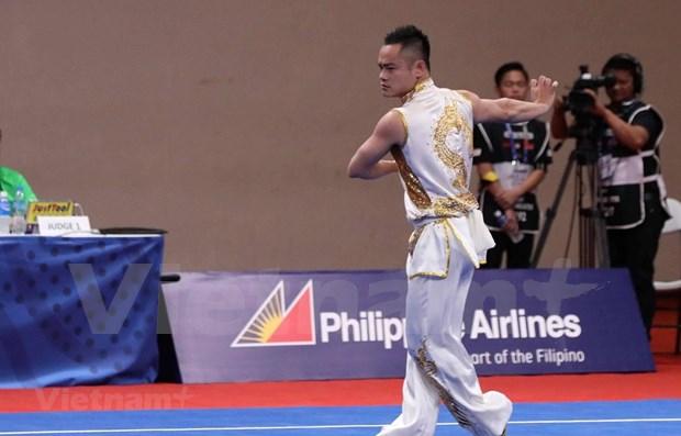 Abre tercera jornada de los SEA Games 30 con oro para Vietnam en Wushu hinh anh 1