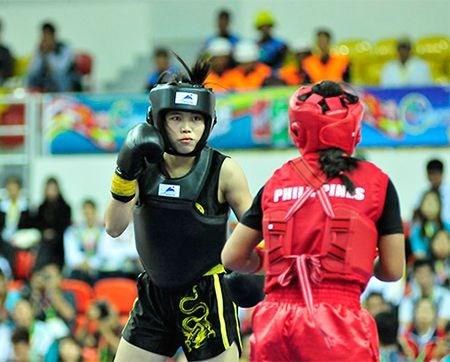 Consigue wushuista vietnamita cuarta medalla de oro en tercera jornada de competencia regional hinh anh 1