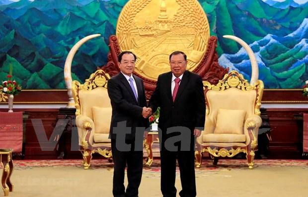 Oficinas presidenciales de Vietnam y Laos por intensificar lazos en labores profesionales hinh anh 1