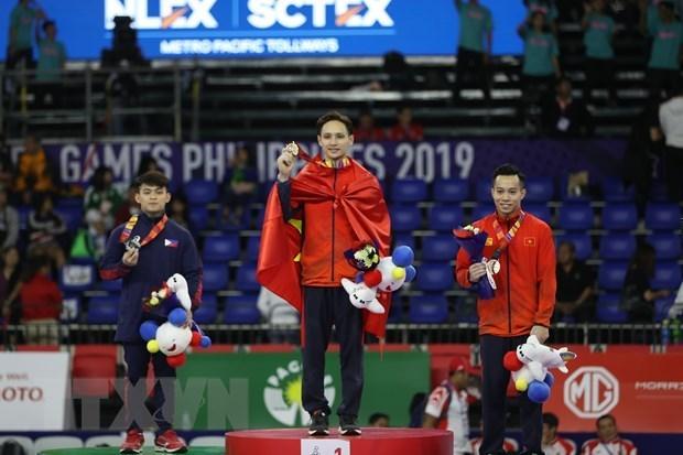 Mantiene Vietnam segundo lugar en SEA Games 30 hinh anh 1