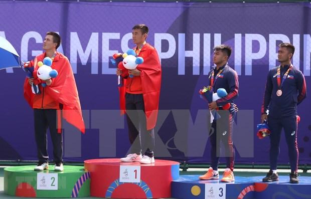 SEA Games 30: Ly Hoang Nam gana historica medalla de oro para tenis de Vietnam hinh anh 1