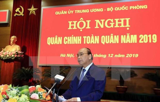 Resalta primer ministro de Vietnam aporte de las Fuerzas Armadas a la seguridad nacional hinh anh 1