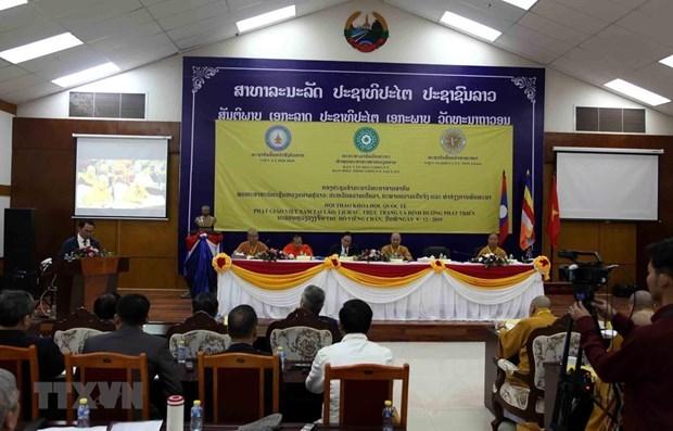 Efectuan simposio internacional sobre el desarrollo del budismo vietnamita en Laos hinh anh 1