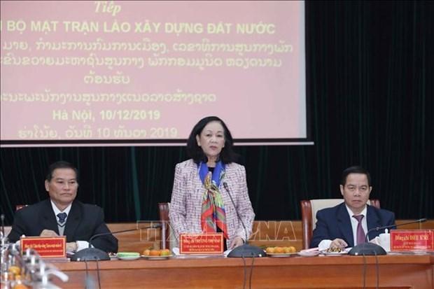 Dirigente vietnamita recibe a delegacion de organizacion de masas de Laos hinh anh 1