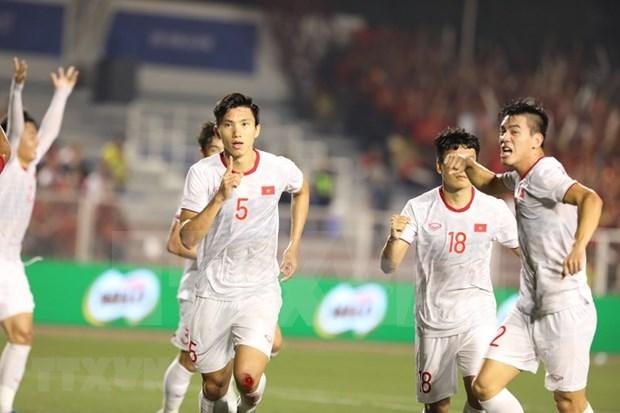 Alaba prensa asiatica coronacion de la seleccion de futbol vietnamita en competencia regional hinh anh 1