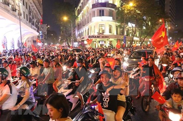 Vietnamitas sin dormir para celebrar triunfo del futbol masculino en SEA Games 30 hinh anh 1