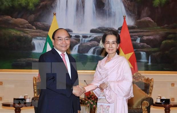 Dialogan primer ministro de Vietnam y asesora de Estado de Myanmar hinh anh 1