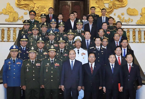 Recibe premier de Vietnam a ministros de defensa de Camboya y Laos hinh anh 1