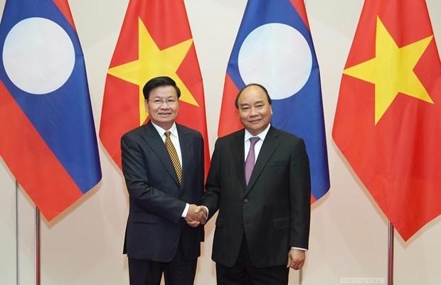 Enfatiza Laos la importancia de cooperacion con Vietnam hinh anh 1