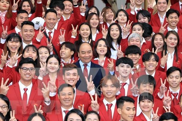 Premier vietnamita destaca desempeno de delegacion nacional en SEA Games 30 hinh anh 1