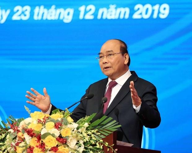 Premier vietnamita se compromete a seguir acompanando a la comunidad empresarial hinh anh 1