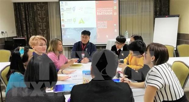Participan empresas vietnamitas en actividad de promocion comercial en Rusia hinh anh 1
