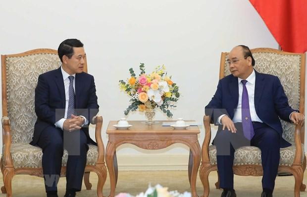 Recibe primer ministro de Vietnam al canciller laosiano hinh anh 1