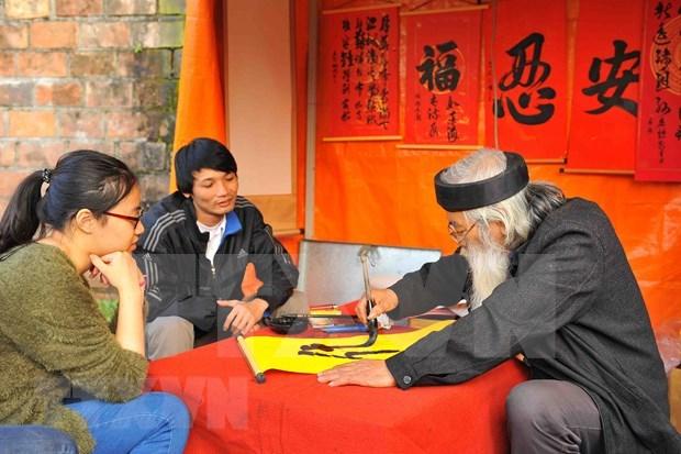 Recrearan en Hanoi atmosfera de celebracion tradicional de Ano Nuevo Lunar hinh anh 1