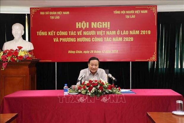 Intensifican los lazos entre la comunidad vietnamita en Laos hinh anh 1