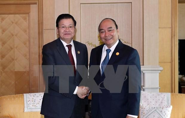 Copresidira premier de Laos reunion del Comite Intergubernamental de cooperacion con Vietnam hinh anh 1