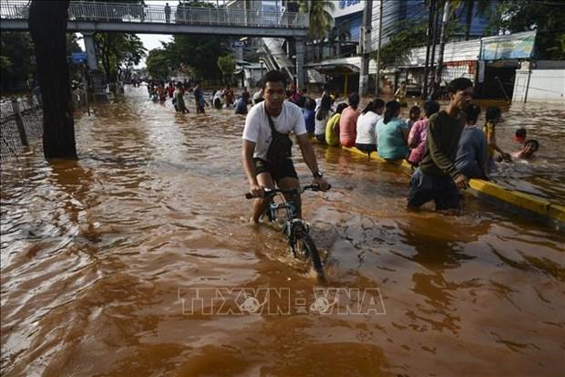 Aceleran en Indonesia operaciones de rescate de victimas por inundaciones hinh anh 1