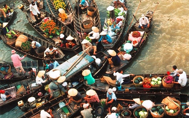 Prensa extranjera presenta mercados flotantes en delta del rio Mekong en Vietnam hinh anh 1