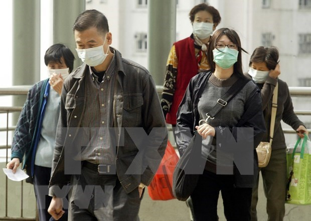 Vietnam alerta a pobladores ante brote de neumonia aguda en China hinh anh 1