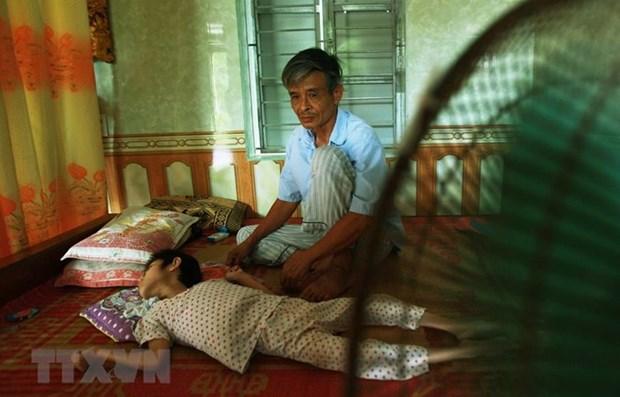 Mejoran calidad del cuidado a victimas vietnamitas del Agente Naranja hinh anh 1