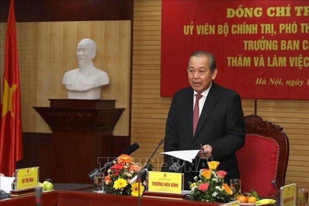 Representantes del Gobierno vietnamita felicitan a policias y pobladores en ocasion del Tet hinh anh 1