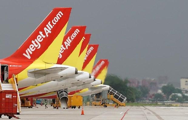 Supervisan salud de tripulacion en vuelos de Vietjet Air a Wuhan hinh anh 1