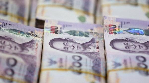 Desvalorizada moneda nacional de Tailandia por nuevo brote del coronavirus hinh anh 1