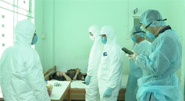 Ciudadano repatriado de Wuhan, noveno caso de coronavirus en Vietnam hinh anh 1