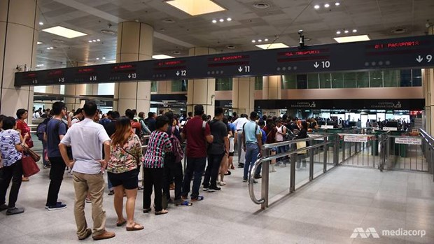 Detendra Singapur admision de documentos de viaje colectivo de Malasia hinh anh 1