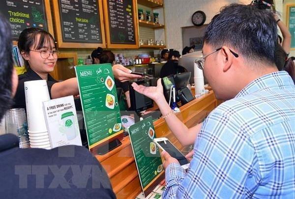 Promueven en Vietnam pago electronico para prevenir el contagio del nCoV hinh anh 1