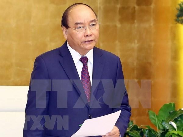 Premier de Vietnam exhorta a apoyar el intercambio comercial ante propagacion de coronavirus hinh anh 1