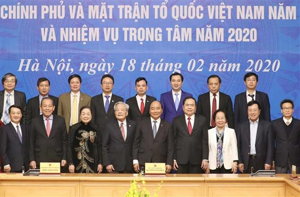Revisan coordinacion entre el gobierno y la mayor organizacion de masas de Vietnam hinh anh 1