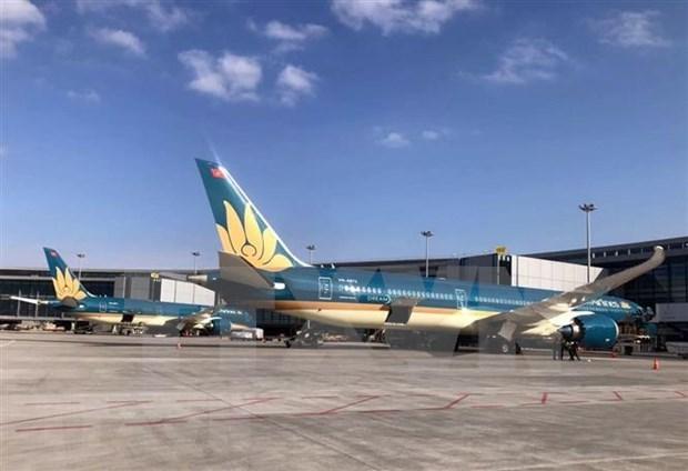 Garantiza Vietnam Airlines cumplimento con las regulaciones preventivas de COVID-19 hinh anh 1