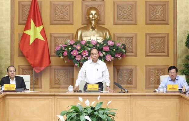Vietnam tiene suficientes recursos para controlar epidemia de COVID-19, afirma premier hinh anh 1