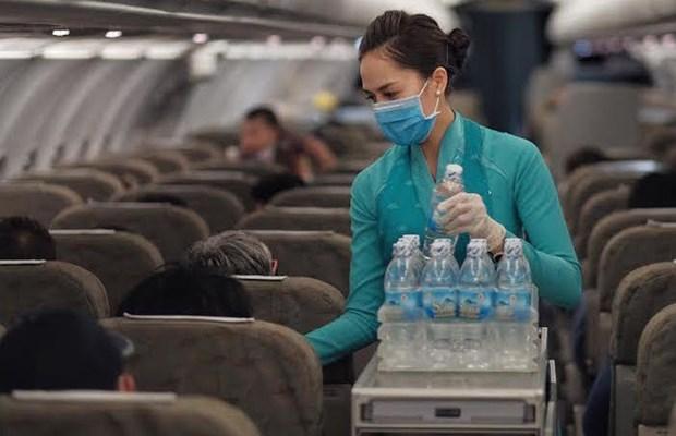Pasajeros deberan llevar mascarillas sanitarias en vuelos y aeropuertos de Vietnam hinh anh 1