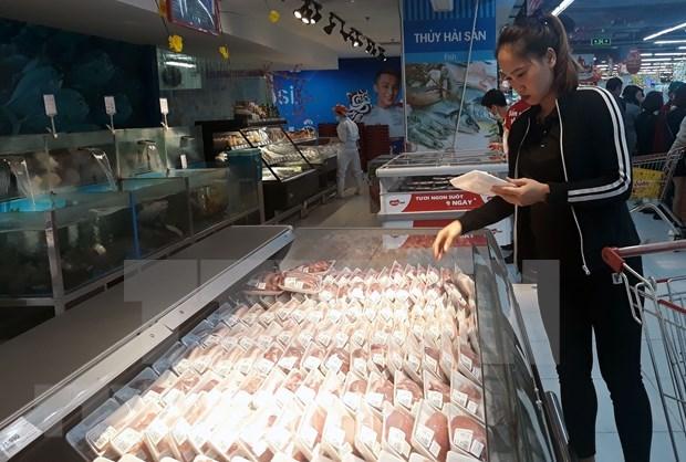 Primer ministro de Vietnam pide bajar el precio de la carne de cerdo hinh anh 1