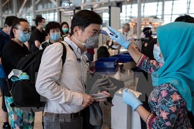 Paises del Sudeste Asiatico intensifican medidas preventivas contra COVID- 19 hinh anh 1