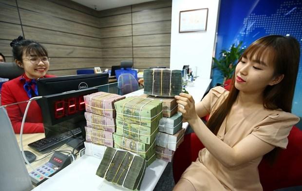 Banco Estatal de Vietnam adopta cambios flexibles para hacer frente a impactos de COVID-19 hinh anh 1