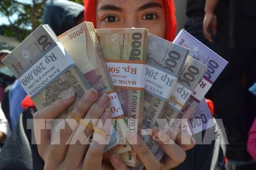 Rupia de Indonesia se acerca a su peor nivel desde la crisis de 1998 hinh anh 1