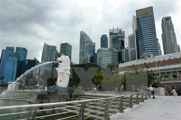 Singapur prohibira a visitantes por temor de COVID-19 hinh anh 1