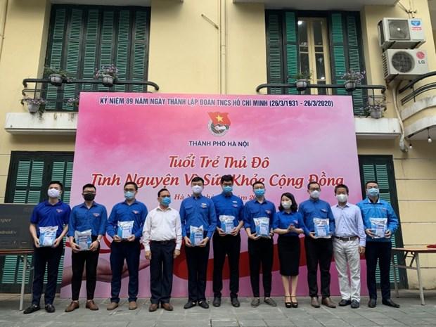 Jovenes de Hanoi se unen para proteger salud publica ante pandemia hinh anh 1