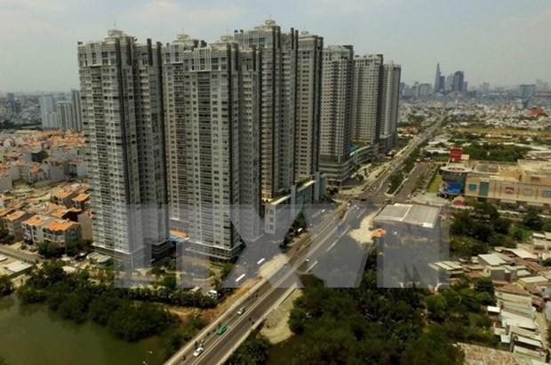 Fitch Solutions ajusta a la baja pronostico de crecimiento de Vietnam hinh anh 1